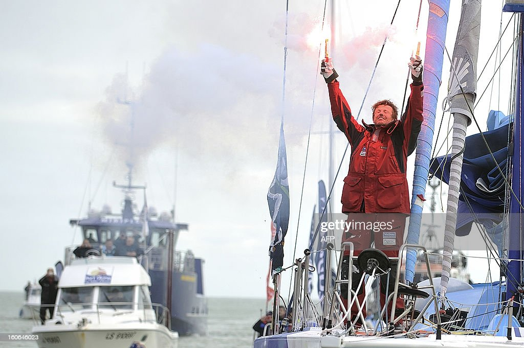 French skipper Jean-Pierre Dick celebrates on his monohull 'Virbac Paprec 3' as he finished fourth in the Vendee Globe solo round-the-world race on February 4, 2013 in Les Sables d'Olonne, western France.Dick sailed without a keel since January 22.