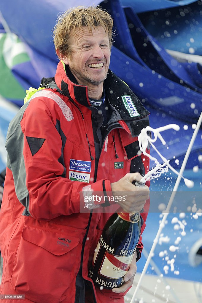 French skipper Jean-Pierre Dick sprays champagne on his monohull 'Virbac Paprec 3' as he finished fourth in the Vendee Globe solo round-the-world race on February 4, 2013 in Les Sables d'Olonne, western France. Dick sailed without a keel since January 22.