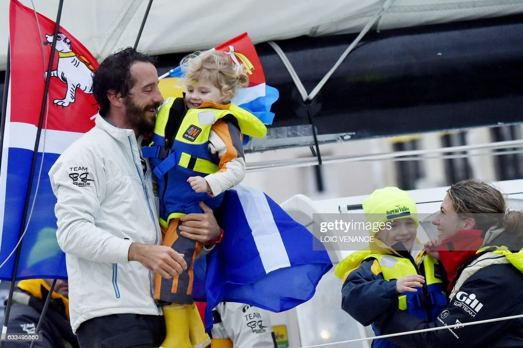 French skipper Louis Burton L is welcomed by his companion