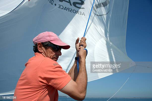 French skipper Marc Guillemot attends a training on the monohull 'Safran' on September 25 2013 off the coast of La TrinitésurMer western of France as...