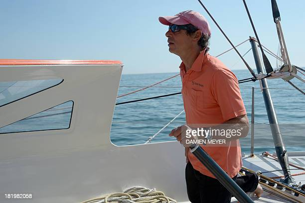 French skipper Marc Guillemot attends a trainning on the monohull 'Safran' on September 25 2013 off the coast of La TrinitésurMer western of France...