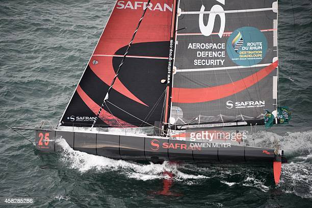 French skipper Marc Guillemot competes on his Imoca multihull 'Safran' in the 10th edition of the Route du Rhum sailing race in SaintMalo western...