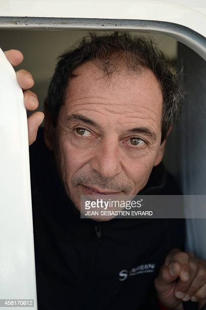 French skipper Marc Guillemot poses aboard his Imoca class monohull in Saint Malo in western France on October 31 2014 before the 10th edition of the...