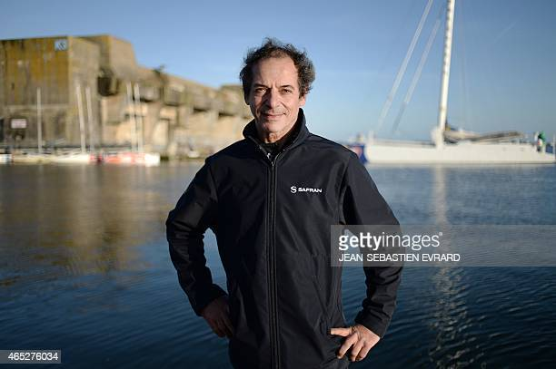 French skipper Marc Guillemot poses as the new Class Imoca Monohull 'Safran' is launched on March 5 2015 in Lorient western France French skipper...