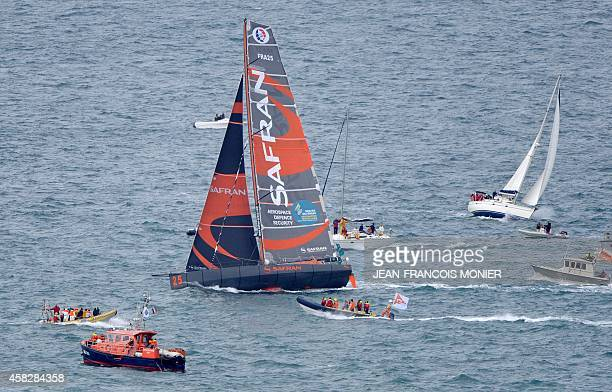 French skipper Marc Guillemot sails his Class Imoca monohull 'Safran' off Cap Frehel near Plevenon western France after the start of the 10th edition...