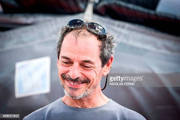 French skipper Marc Guillemot smiles aboard his monohull Safran upon his arrival in PointeaPitre on the French overseas department of Guadeloupe on...