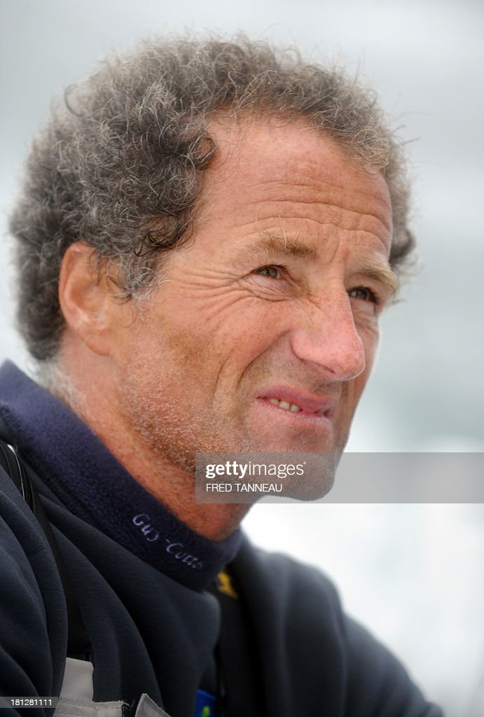 French skipper Michel Desjoyeaux is pictured during a training aboard the monohull 'Macif' on September 19, 2013 off the coast of Lorient, western of France, as part of his preparation for the Transat Jacques Vabre. The 11th edition of the Transat Jacques Vabre will start from French northwestern city of Le Havre on November 3, 2013 to Brazilian city of Itajai. Fourty-four teams are engaged in four categories (Class40, Imoca, Multi50 et MOD70).
