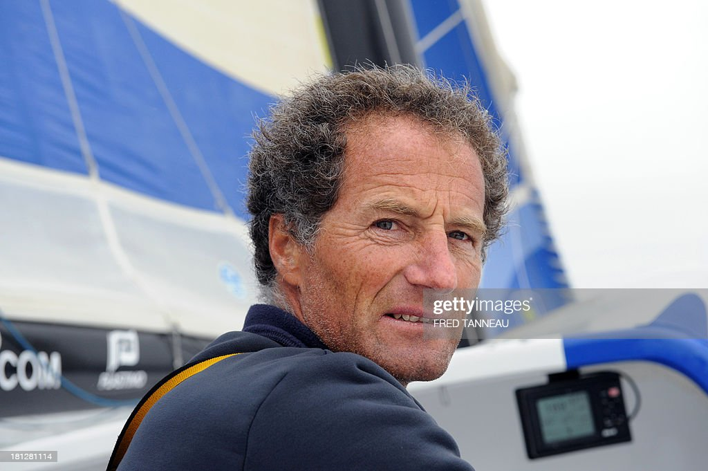 French skipper Michel Desjoyeaux is pictured during a training aboard the monohull 'Macif' on September 19, 2013 off the coast of Lorient, western of France, as part of his preparation for the Transat Jacques Vabre. The 11th edition of the Transat Jacques Vabre will start from French northwestern city of Le Havre on November 3, 2013 to Brazilian city of Itajai. Fourty-four teams are engaged in four categories (Class40, Imoca, Multi50 et MOD70). AFP PHOTO/FRED TANNEAU