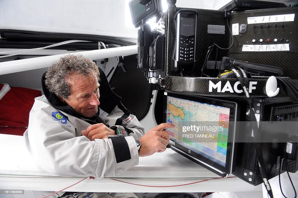 French skipper Michel Desjoyeaux looks at a map during a training aboard the monohull 'Macif' on September 19, 2013 off the coast of Lorient, western of France, as part of his preparation for the Transat Jacques Vabre. The 11th edition of the Transat Jacques Vabre will start from French northwestern city of Le Havre on November 3, 2013 to Brazilian city of Itajai. Fourty-four teams are engaged in four categories (Class40, Imoca, Multi50 et MOD70).