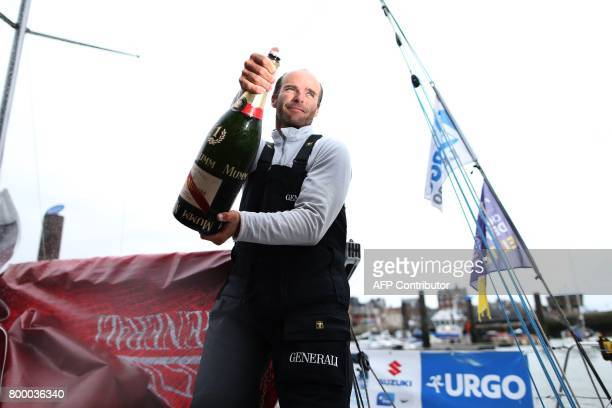 TOPSHOT French skipper Nicolas Lunven celebrates aboard his monohull 'Generali' after winning the 48th Solitaire du FigaroUrgo solo sailing race on...