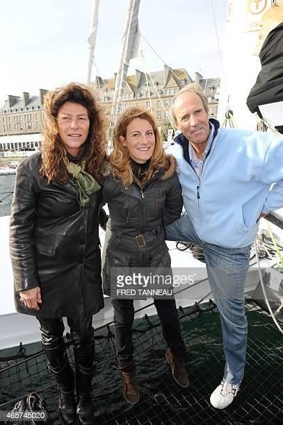 French skipper of the 'Saint Malo 2015' multihull Servane Escoffier poses with former skippers Florence Arthaud and Marc Pajot on October 29 2010 on...