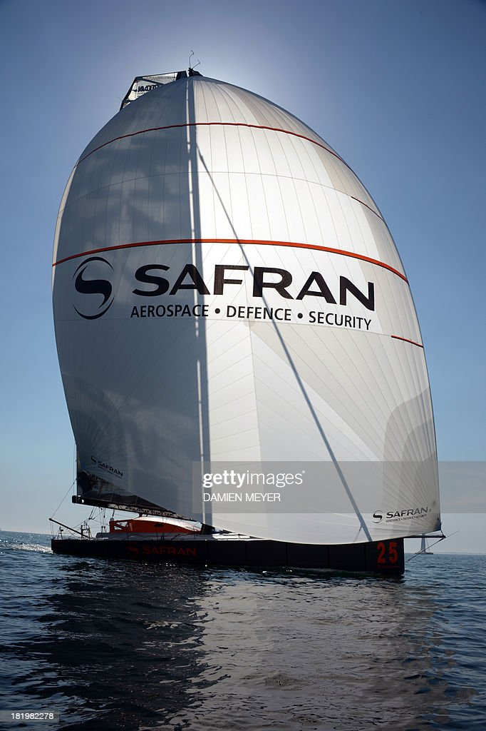 French skipper Pascal Bidegorry and Marc Guillemot attend a training on the monohull 'Safran' on September 25, 2013 off the coast of La Trinité-sur-Mer, western of France as part of their preparation for the Transat Jacques Vabre. The 11th edition of the Transat Jacques Vabre will start on November 3rd from Le Havre to Itajai, Brazil. Fourty-four teams are engaged in four categories (Class40, Imoca, Multi50 et MOD70).