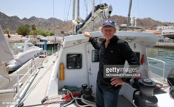French skipper Philippe Poupon poses for a picture aboard a sailing boat docked at a marina in the Omani capital Muscat on April 26 2017 Poupon a...