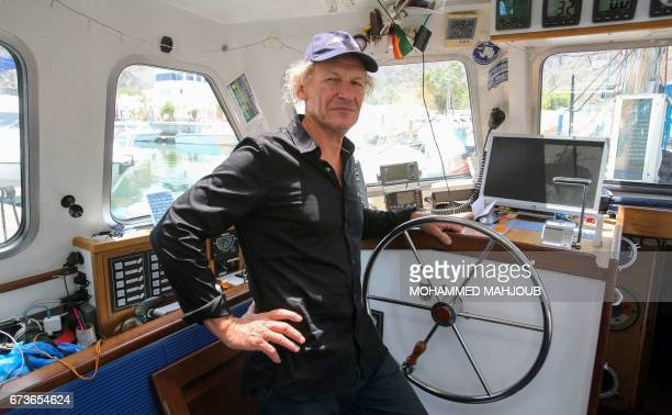 French skipper Philippe Poupon poses for a picture in a sailing boat in the Omani capital Muscat on April 26 2017 Poupon a 62yearold adventurer has...
