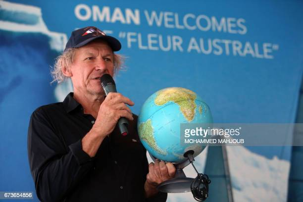 French skipper Philippe Poupon speaks as he carries a small globe in his hand during a press conference in the capital Muscat on April 26 2017 Poupon...