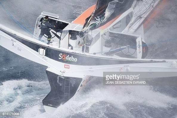French skipper Thomas Coville navigates aboard his multihull 'Sodebo Ultim' on October 12 2016 off La TrinitesurMer western France Coville prepares...