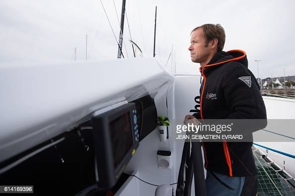 French skipper Thomas Coville poses aboard his multihull 'Sodebo Ultim' on October 12 2016 at La TrinitesurMer western France Coville prepares for a...