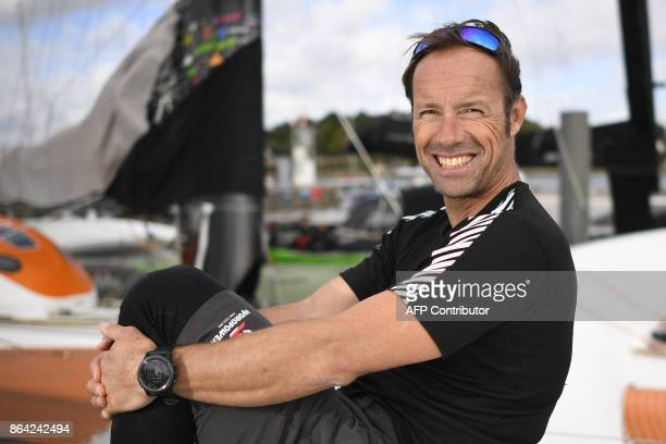 French skipper Thomas Coville poses for photographer aboard the 'Sodebo' Ultim multihull after a training session off the coast of La TrinitesurMer...