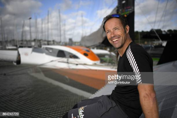French skipper Thomas Coville poses for photographer on the 'Sodebo' Ultim multihull after a training session off the coast of La TrinitesurMer...