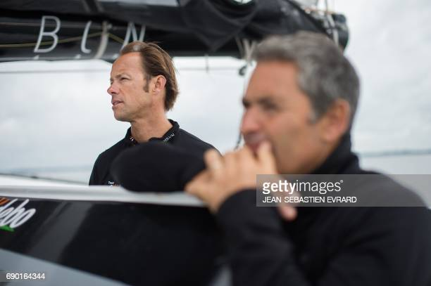 French skipper Thomas Coville sails with his team aboard his multihull 'Sodebo Ultim' on May 30 2017 off La TrinitesurMer western France Coville...