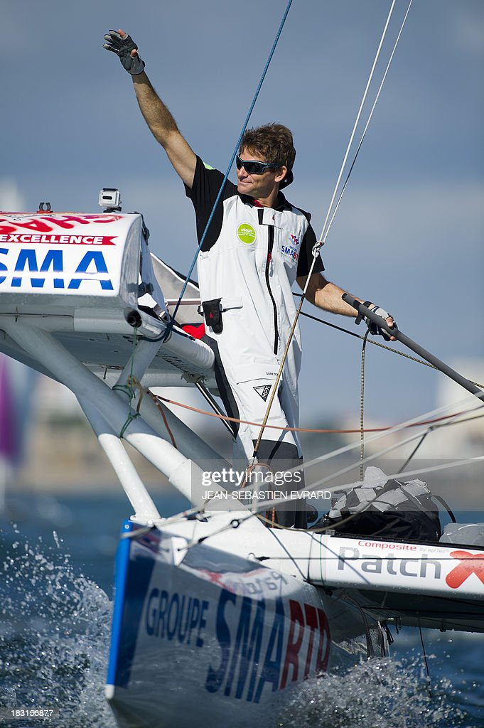 French skipper Vincent Beauvarlet is seen as he takes the start with Swiss skipper Yvan Bourgnon for one-year trip around the world without assistance on their 6,40m multi hull 'Défi SMA'on october 5, 2013 in Les Sables d'Olonne, western France. AFP PHOTO / JEAN-SEBASTIEN EVRARD