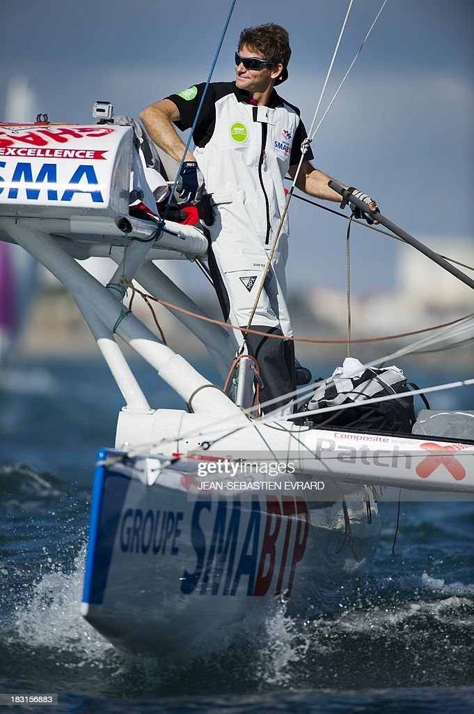 French skipper Vincent Beauvarlet is seen as he takes the start with Swiss skipper Yvan Bourgnon for one-year trip around the world without assistance on their 6,40m multi hull 'Défi SMA'on october 5, 2013 in Les Sables d'Olonne, western France.