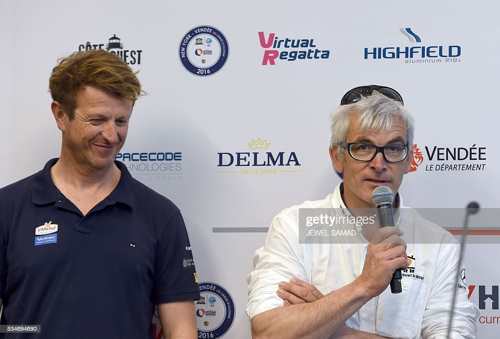 French skipper Vincent Riou (R) answers a question as his compatriot Jean-Pierre Dick looks on during a press conference ahead of the New York-Vendee Race, on May 27, 2016 in New York. / AFP / Jewel SAMAD