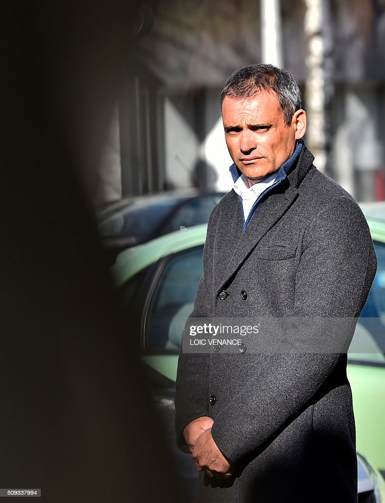 French skipper Yann Guichard arrives to attend his trial at the courthouse of Lorient, western France, on February 10, 2016. On June 16, 2015 his multihull Spindrift 2 hit a race official boat at the start of the 9th Leg of the Volvo Ocean Race between Lorient and Goteborg, off the coast of Lorient. Virginie Le Namouric lost a leg in the accident. / AFP / LOIC VENANCE