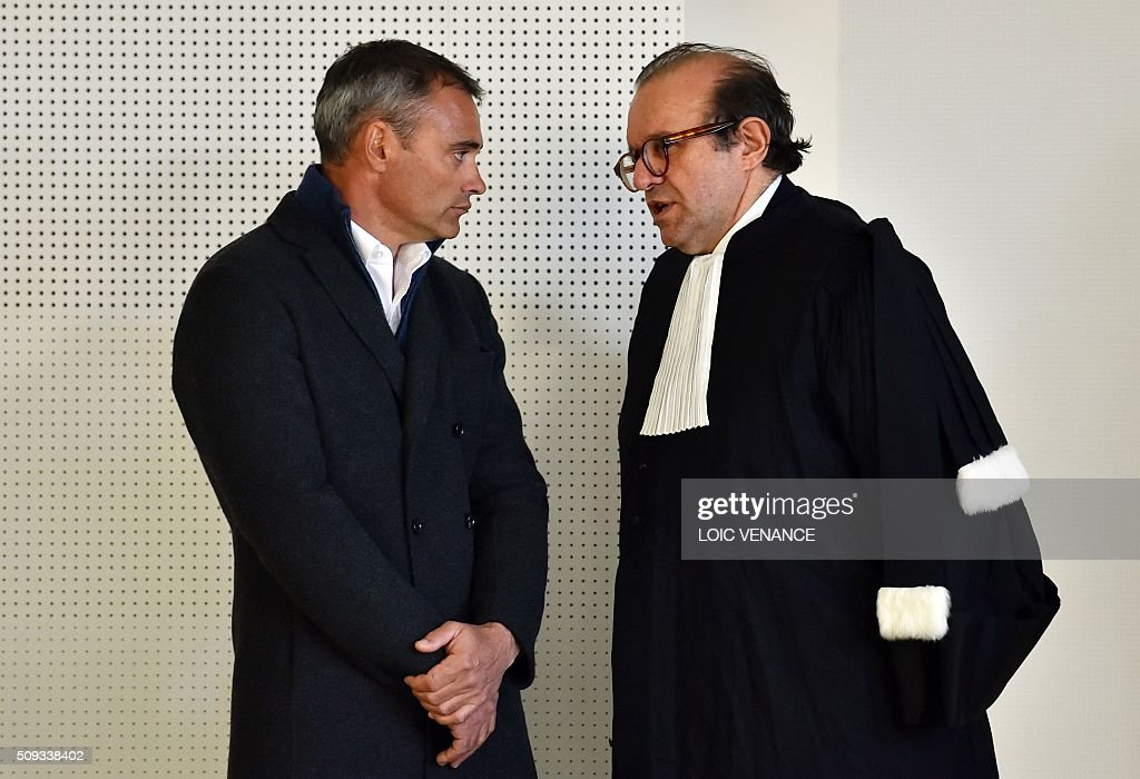French skipper Yann Guichard (L) talks to his lawyer Herve Temime before the start of his trial at the courthouse of Lorient, western France, on February 10, 2016. On June 16, 2015 his multihull Spindrift 2 hit a race official boat at the start of the 9th Leg of the Volvo Ocean Race between Lorient and Goteborg, off the coast of Lorient. Virginie Le Namouric lost a leg in the accident. / AFP / LOIC VENANCE