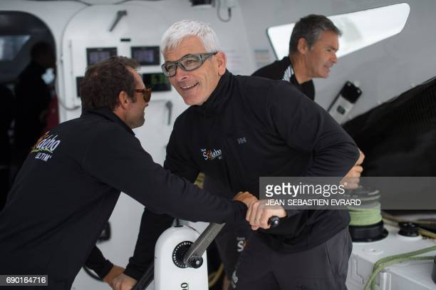 French skippers Billy Besson and Vincent Riou sail aboard the multihull 'Sodebo Ultim' of Thomas Coville on May 30 2017 off La TrinitesurMer western...