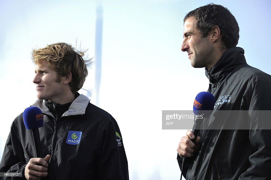 French skippers Francois Gabart (L) and Armel Le Cleach speaks to journalists on January 28, 2013 in Les Sables d'Olonne, western France, the day after they respectively won and finished second of the seventh Vendee Globe round-the-world race, after a two-and-a-half month epic journey which saw him set a new record for the course.