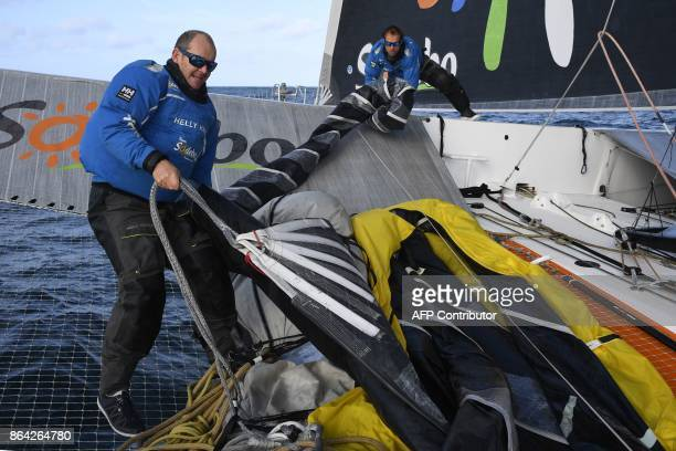 French skippers JeanLuc Nelias and Thomas Coville prepare the 'Sodebo' Ultim multihull prior to sailing during a training session off the coast of La...