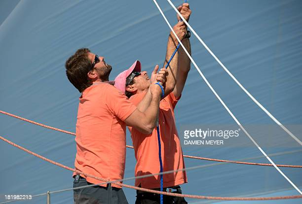 French skippers Marc Guillemot and Pascal Bidegorry attend a trainning on the monohull 'Safran' on September 25 2013 off the coast of La...