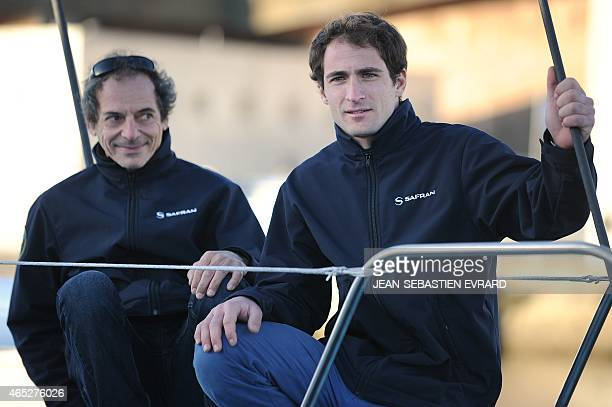 French skippers Morgan Lagraviere and Marc Guillemot pose as the new Class Imoca Monohull 'Safran' is launched on March 5 2015 in Lorient western...