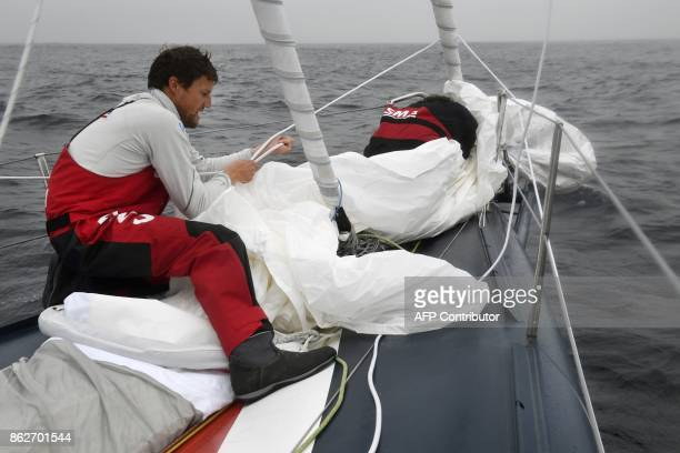French skippers Paul Meilhat and Gwenole Gahinet sail on an SMA monohull off the coast of la ForetFouesnant western France on October 17 2017 / AFP...