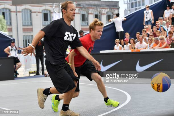 French skippers Thomas Coville and Francois Gabart run for the ball during a 3X3 basketball exhibition game on the sidelines of the World...
