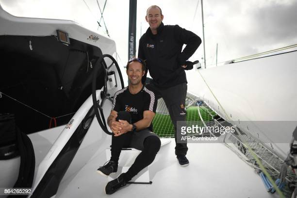 French skippers Thomas Coville and JeanLuc Nelias pose for photographer aboard the 'Sodebo' Ultim multihull after a training session off the coast of...