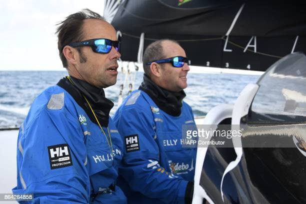 French skippers Thomas Coville and JeanLuc Nelias sail aboard the 'Sodebo' Ultim multihull during a training session off the coast of La...