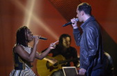 French slam poet Fabien Marsaud aka Grand Corps Malade and Nigerian singer Bukola Elemide aka Asa perform on stage during the 29th Victoires de la...