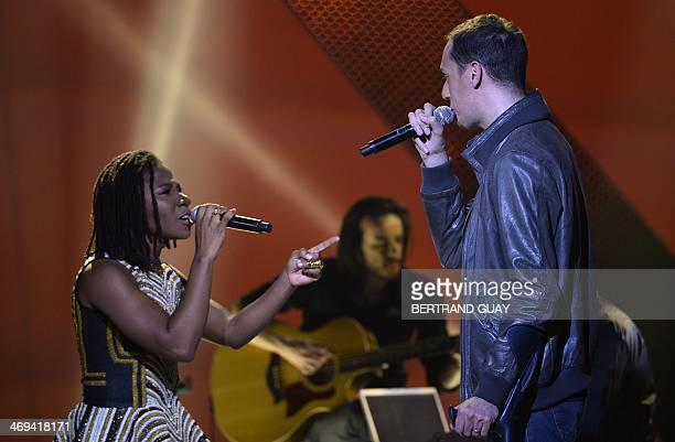 French slam poet Fabien Marsaud aka Grand Corps Malade and Nigerian singer Bukola Elemide aka Asa perform on stage during the 29th Victoires de la...