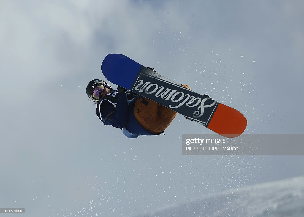 French snowboarder Sophie Rodriguez competes in the Ladies' Snowboard Half-Pipe final race at the Snowboard and FreeStyle World Cup Super finals at Sierra Nevada ski resort near Granada on March 27, 2013. Sophie Rodriguez won the race. AFP PHOTO / PIERRE-PHILIPPE MARCOU