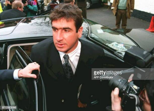 French soccer star Eric Cantona arrives at a hotel in Saint Albans in London to appear before a Football Association disciplinary commission 24...