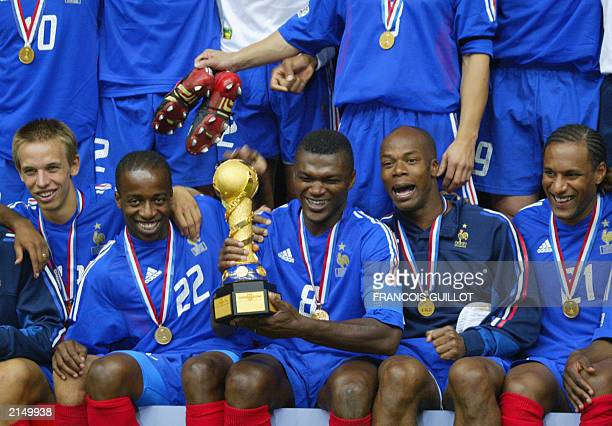 French soccer team jubilate at the end of their soccer Confederations Cup final match against Cameroon 29 June 2003 at the Stade de France in...