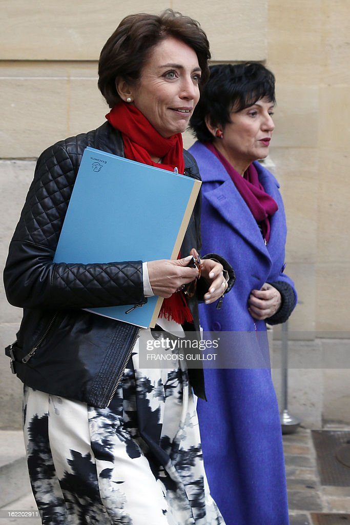 French Social Affairs and Health Minister Marisol Touraine (L) and French Junior Minister for Family Dominique Bertinotti leave following a lunch with French Prime Minister and French government's ministers focused on budget on February 20, 2013 at the Hotel Matignon, the Prime Minister official residence, in Paris.