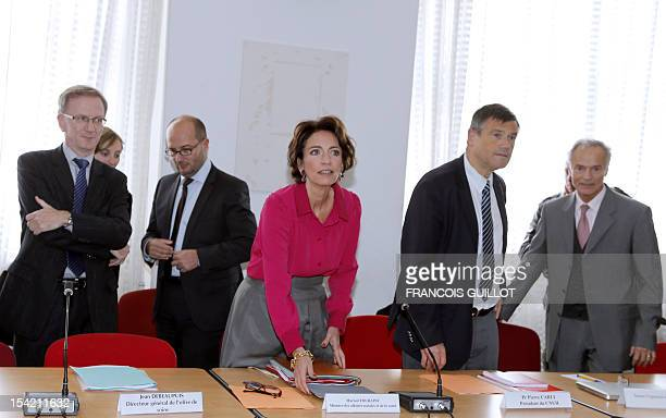 French Social Affairs and Health Minister Marisol Touraine arrives to head a roundtable meeting focused on organizing hospital emergency units on...