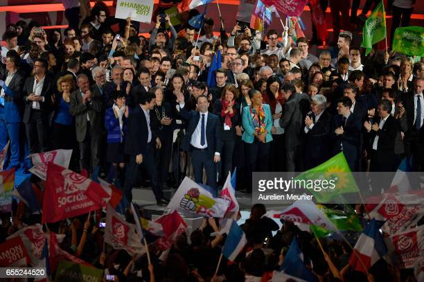 French Socialist candidate for the president Benoit Hamon salutes voters after a political meeting at AccorHotels Arena on March 19 2017 in Paris...