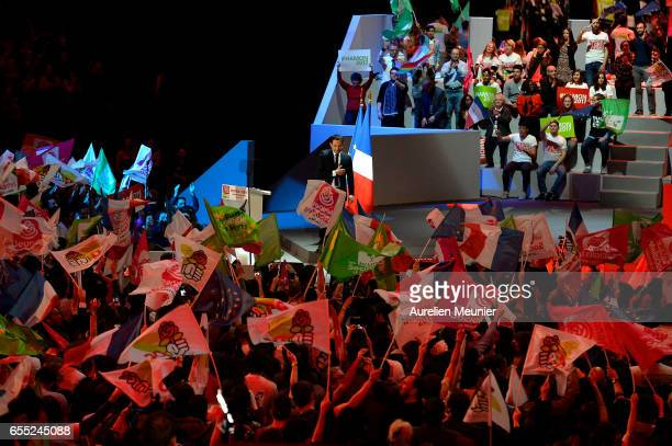 French Socialist candidate for the Presidential Election Benoit Hamon salutes voters as he arrives for a political meeting at AccorHotels Arena on...