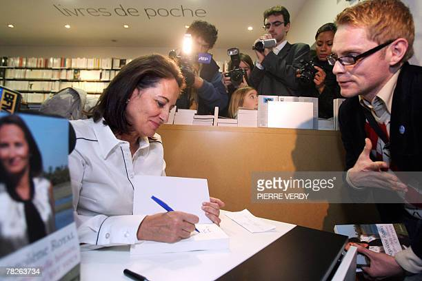 French socialist former candidate for the presidential election Segolene Royal signs her book 'Ma plus belle histoire c'est vous' 05 December 2007 in...