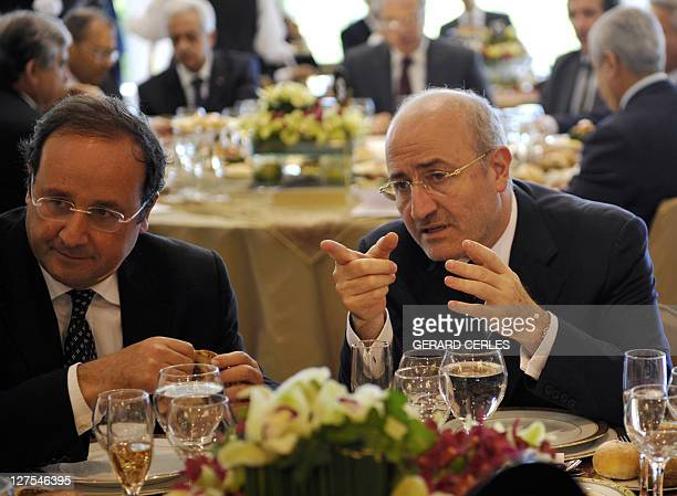 French Socialist leader Francois Hollande listens to former Lebanese information minister Ghazi Aridi during an official lunch at the Presidential...