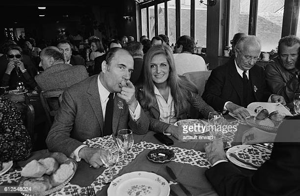 French socialist leader Francois Mitterrand has lunch with Egyptianborn singer Dalida in Chateau Chinon